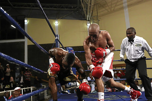 Simpiwe 'V12' Vetyeka stops Thompson Mokwana in the eighth round of their lightweight bout at the Orient Theatre.