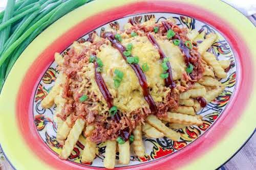 "Redneck Nachos ""Crispy salted crinkle cut french fries smothered in pulled pork..."