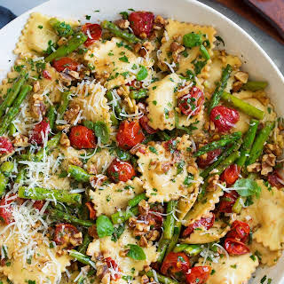 Ravioli with Tomatoes Asparagus Garlic and Herbs.