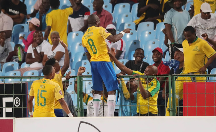 Mamelodi Sundowns captain Hlompho Kekana celebrates with the fans after scoring the winning goal with a stupendous free kick.