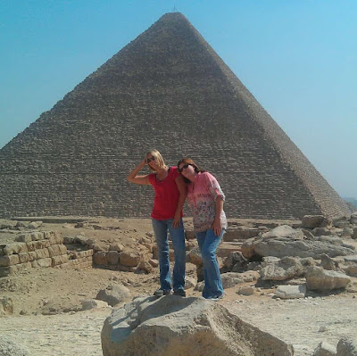 Mother Daughter Travel to Cairo Egypt posing together at the pyramids of giza