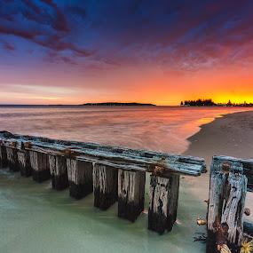 Beauty sundown by Nicole Rix - Landscapes Sunsets & Sunrises ( clouds, fence, sand, sky, sunset, beach, seascape, colours,  )