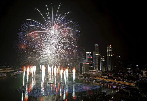 Fireworks explode in Marina Bay against the skyline of Singapore during New Year's Day celebrations January 1 2016. Picture: REUTERS/EDGAR SUR