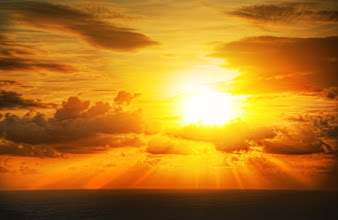 Photo: The sun burns slowly down into the deep sea...