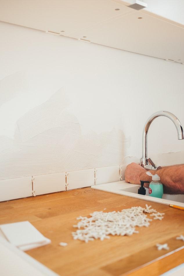 Plumber repairing a faucet