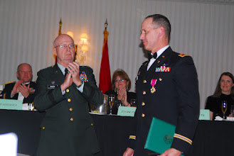 Photo: Soldiers and their guests join together for the 34th Combat Aviation Brigade Ball at the Marriott in Bloomington, Minnesota on the night of December 8th, 2007.  Dinner was served, awards were given to honor both Soldiers and families, distinguished speaker Chaplin John Morris (LT COL) gave a speech which received a standing ovation by the crowd and the night was turned back over to the Soldiers for a social hour.