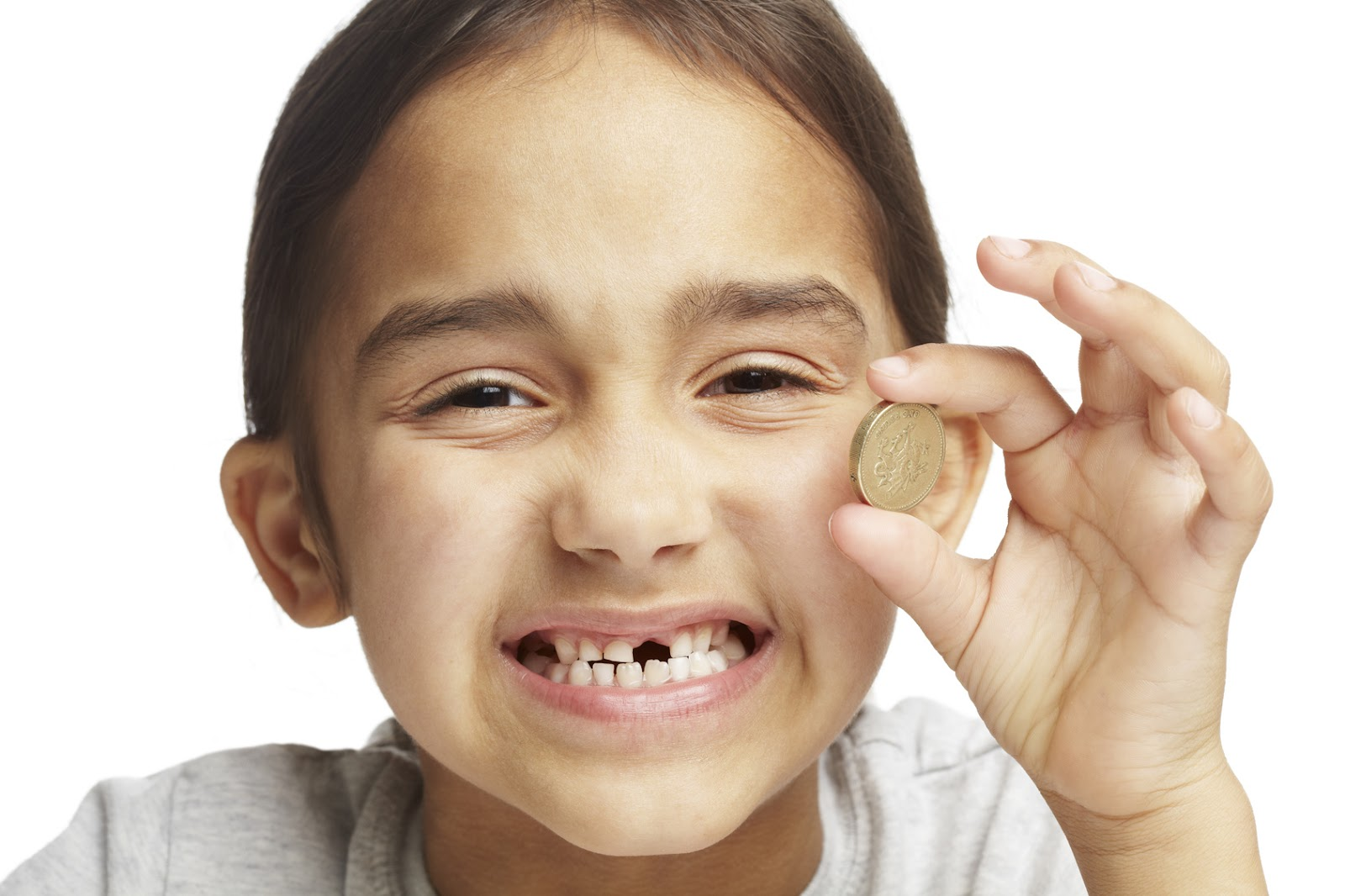 girl with missing tooth holding a coin.jpg