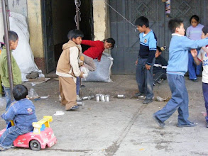 Photo: Kids playing skittles with old cans