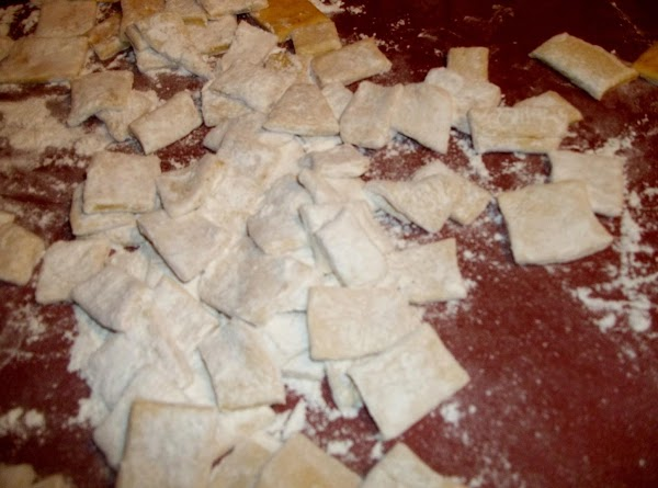 Loosen the dumplings from work space and sprinkle with flour. (Use the flour you...