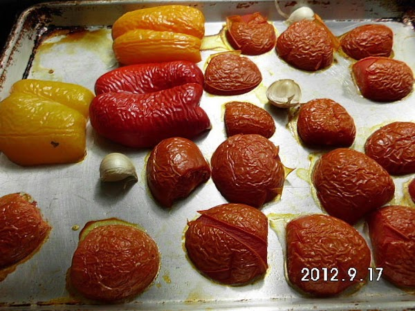 Cut tomatoes and peppers in half.  Remove stems and seeds from peppers. ...