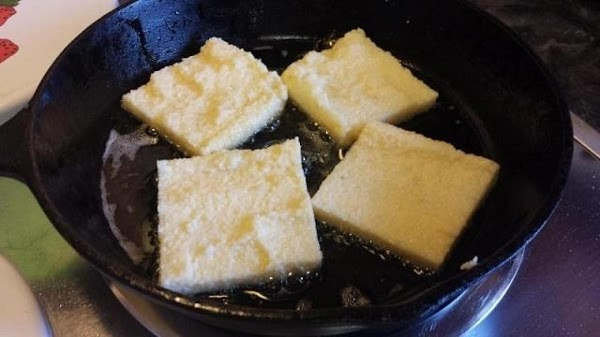 Fry the squares in two to three batches. Heat about a third of the...