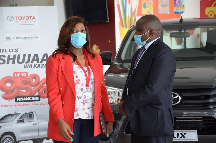 Toyota Kenya's Rose Musumba and Co-op Bank asset finance product manager Paul Wambugu