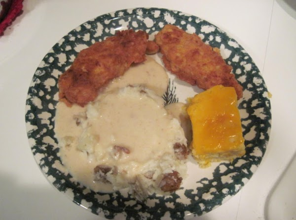 Fried Chicken tenders with smashed potatoes, gravy and three cheese and cheddar spoon bread