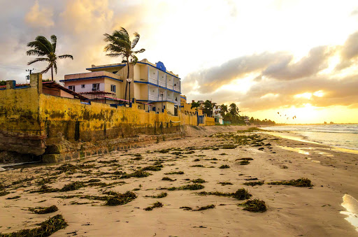 Cuba-Beach-Landscape-at-Dusk-with-Building_01.jpg - A beach scene in Cuba.