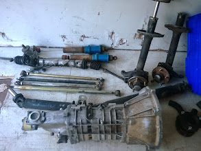 Photo: spare shocks, strut housings for stock volvo inserts (un tested) transmission, driveshaft, links, top mounts, steering rack.