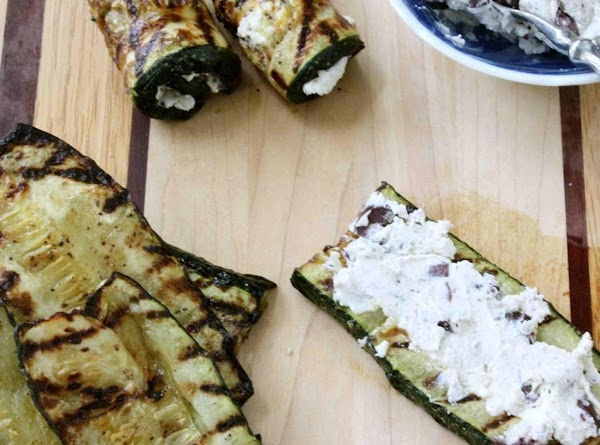 Preheat grill to high heat.  Slice a strip lengthwise from the zucchini to expose the...