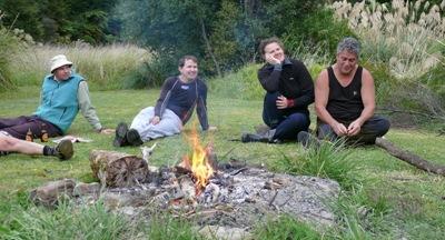 Sitting around the fire at Upokororo Bay