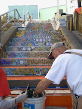 Photo: Third full day of work (October 29, 2013) with KZ Tile workers (Sing on left, Henry on right) installing the first sections of the Hidden Garden Steps (16th Avenue, between Kirkham and Lawton streets in San Francisco's Inner Sunset District) 148-step ceramic-tile mosaic designed and created by project artists Aileen Barr and Colette Crutcher. For more information about this volunteer-driven community-based project supported by the San Francisco Parks Alliance, the San Francisco Department of Public Works Street Parks Program, and hundreds of individual donors, please visit our website at http://hiddengardensteps.org.