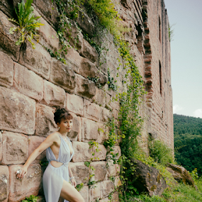 by Johannes Oehl - People Fashion ( muscular, romanesque, dress, castle, female hairstyle, 12th century, thigh, fashion-photography, apparel, rheinland-pfalz, lower arm, upper-arm, looking at camera, building, frankenstein castle, leg, beautiful, lightblue, up do, one female adult only, rhineland-palatinate, full body, place of interest, medieval architecture, wardrobe, female, costume, ruin, brickwork, pfalz, upper leg, defensive wall, german ethnicity, july, 11 brown iris, thin, red sandstone, person, outside, leaning, lawngreen, stone wall, underarm, brick wall, germany, palatinate, martin-schultz scale, sandstone, 55-60 years, summer, arm outstretched, brunette, lower leg, brick, europe, arm, architecture, 1 person, frankenstein, brunet,  )