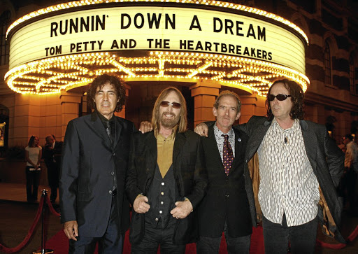 Tom Petty, second left, with the Heartbreakers, Ron Blair, Benmont Tench and Mike Campbell, at the premiere of a documentary about them, in Burbank, California, in 2007. Picture: REUTERS
