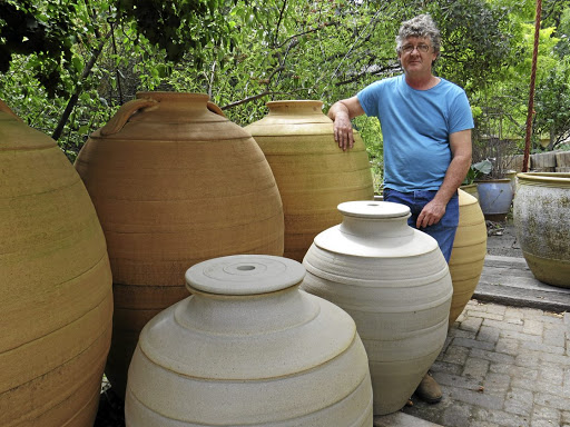 More than a tipple: Potter Yogi de Beer with the large amphoras he creates. Although stoneware is not a new wave in wine making, there is growing demand for the clay vessels. Picture: SUPPLIED