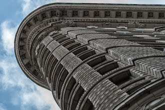 Photo: I've seen descriptions of the Flatiron Building in New York as this big ship coming up Broadway. I think that is an apt description given it's unique shape. This shot was an attempt to capture some of the interesting detail work on the underside of the roof. There really isn't a place on this building that doesn't have some unique design element. Definitely a favorite of mine.  #BreakfastClub curated by +Gemma Costa