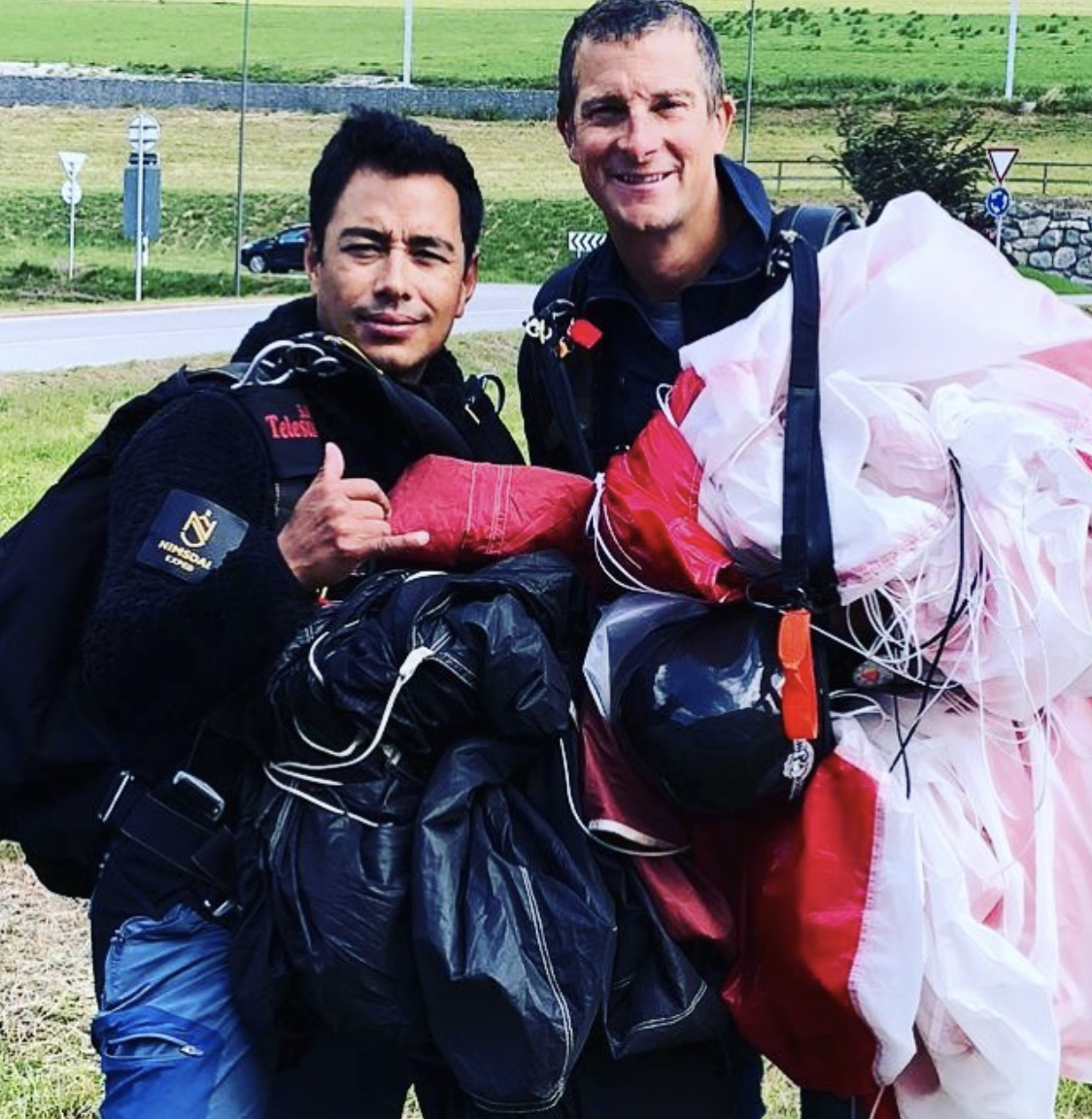 Adventure Reality Star Bear Grylls with parachute after skydiving