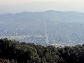 Photo: Zoomed-in view south on the lower end of Upper Colby Trail toward Loraine Avenue in Glendora with South Hills in the background. Notice the rich plant life of the chaparral…it will all be incinerated in a couple weeks.