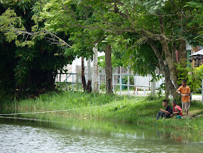 Photo: road Mae Hong Son to Mae Sariang - Khun Yuam lake in centre of village with boys fishing