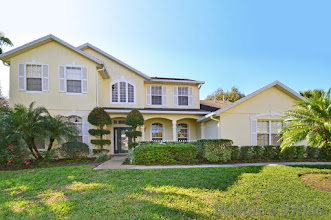Orlando villa close to Disney, gated community,southwest-facing pool and spa, cinema room
