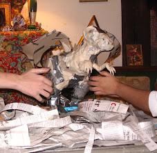 Photo: Papier Mache dragon -- student work in progress.