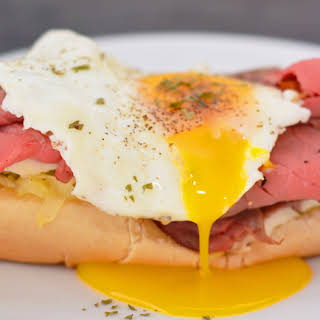 Open Faced Roast Beef Sandwich with Egg and Hashbrowns.