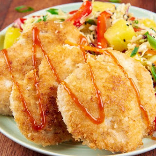 Coconut Crusted Chicken with pineapple slaw and sweet and sour drizzle