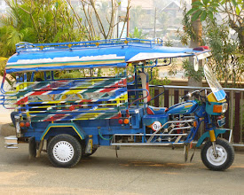 "Photo: We rode around in ""tuk-tuks"" that seat six people plus the driver.  They cost $1 or $2 one-way."