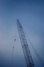 Photo: A crane looms through the San Francisco fog, en route to the Golden Gate bridge