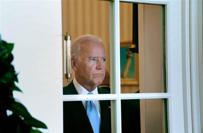 Biden staring out a window.jpg