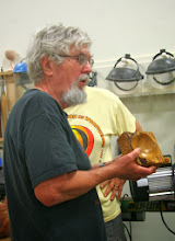 Photo: Ed Karch with a natural-edge square bowl with the sides textured by carving.