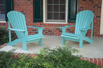 Photo: Adirondack chairs.  Perfect for watching the world go by, sipping a beverage of your choice.  Made from weather resistant cedar; paint optional.
