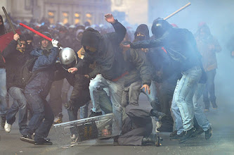 Photo: A policeman (on ground) is being surrounded and hit by demonstrators during a protest of youths to demand a change of government as parliament met to hold a crucial vote that could topple Prime Minister Silvio Berlusconi on December 14, 2010 in Via del Corso in Rome. Italian Prime Minister Silvio Berlusconi scraped through a crucial confidence vote in the lower house of parliament by 314 votes in favour and 311 against. AFP PHOTO / ALBERTO PIZZOLI (Photo credit should read ALBERTO PIZZOLI/AFP/Getty Images)<?