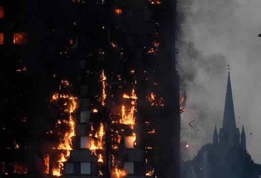 Flames and smoke billow as firefighters deal with a serious fire in a tower block at Latimer Road in West London, Britain June 14, 2017. File photo