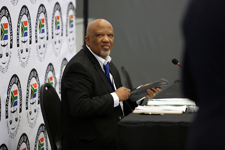 Former deputy finance minister Mcebisi Jonas prepares to testify at the Zondo commission of inquiry into state capture in Parktown, Johannesburg on August 24 2018.