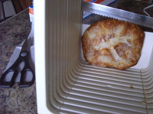 Slice the pretzel buns in half, set aside.