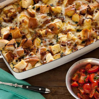 Caramelized Onion, Spinach and Gruyere Cheese Strata with Sauteed Cherry Tomatoes.
