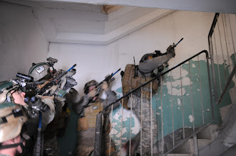 Photo:  On 15 Feb 2010,  Special Forces Soldiers storm towards the second floor of a building after clearing the first floor , during a rehearsal for a night hostage rescue training mission in Germany.  (U.S. Army Photo by: SFC Silas Toney)