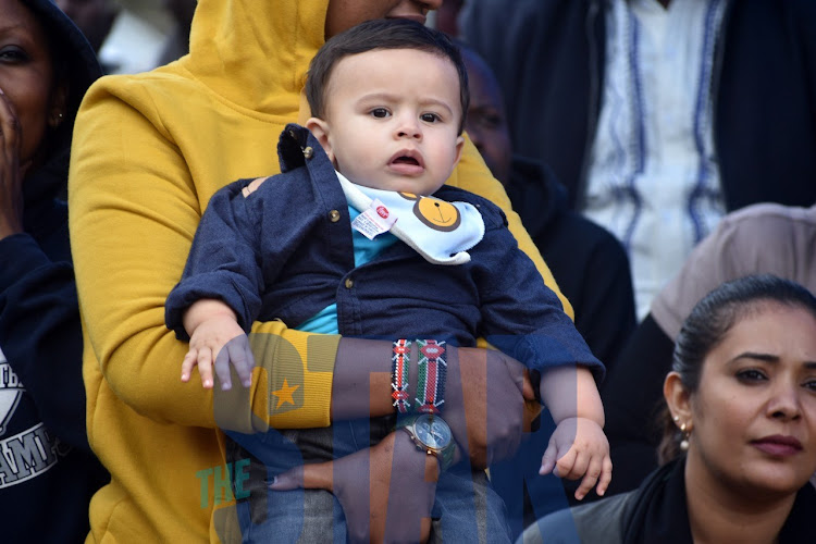A baby watches the goings-on during the Ineos challenge viewing at KICC on Saturday, October 12, 2019.