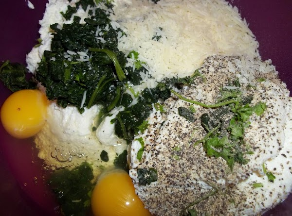 While sauce is simmering,In a large bowl; mix up your filling ingredients. Set aside.  Preheat...