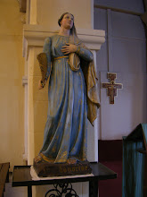 Photo: Here, a statue of Sainte Honorine, the oldest, most revered virgin martyr in Normandy - although little is known of her life. In 876, the monks guarding her relics in Normandy moved them here for safekeeping, placing them in the chapel of the Tour Montjoie fortress. In 1082, the castle was destroyed during a siege, and the monks subsequently built a church outside of the town walls, dedicated to Honorine. Her relics were transported there, and her name added to Conflans in the 13th century, giving the town its present name.
