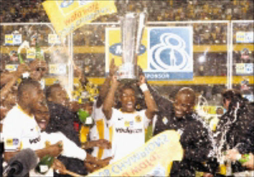 VICTORIOUS: Kaizer Chiefs players celebrate after winning the MTN 8 final against Mamelodi Sundowns at the Absa Stadium in Durban on Tuesday night.  Pic. Chris Ricco. 236/09/2008. © Backpagepix