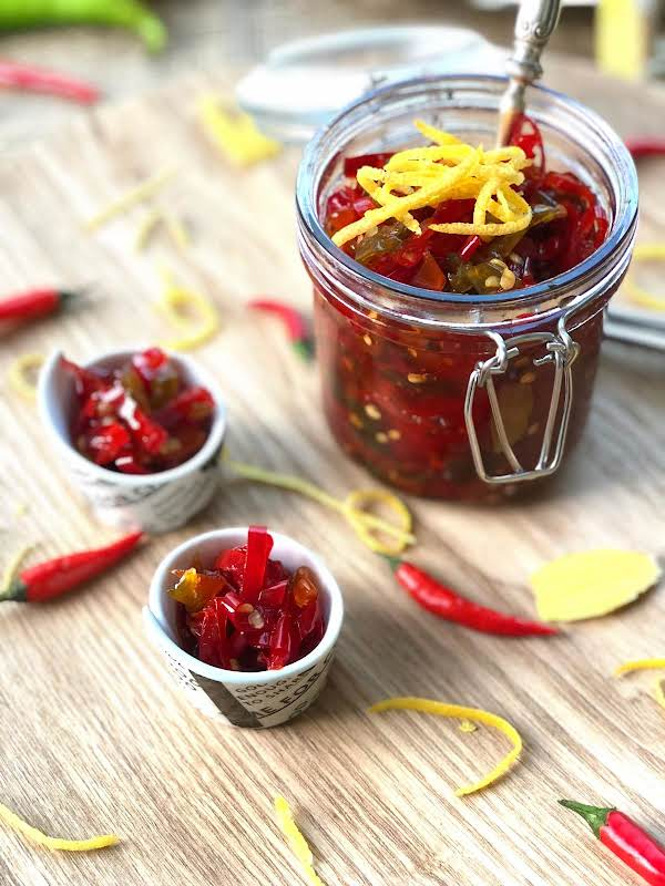 This Flavoursome And So Colourful Piquant Jam Only Contains Ginger, Chillies, Lemon Rind And Honey. It Is A Jam Totally Made In Heaven. It Is A Must Have At All Times.