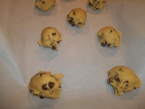 Using my ice cream scoop, I placed cookie dough 2 inches apart on lined...